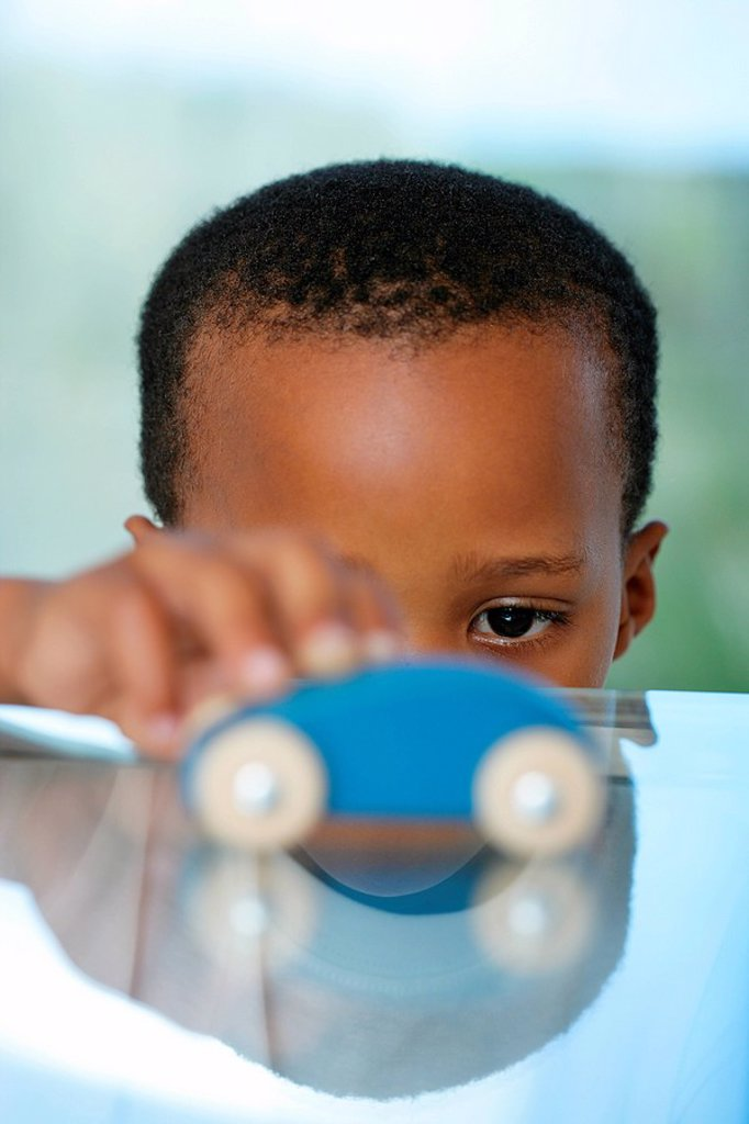 African Boy Playing with a Toy Car  Cape Town, Western Cape : Stock Photo