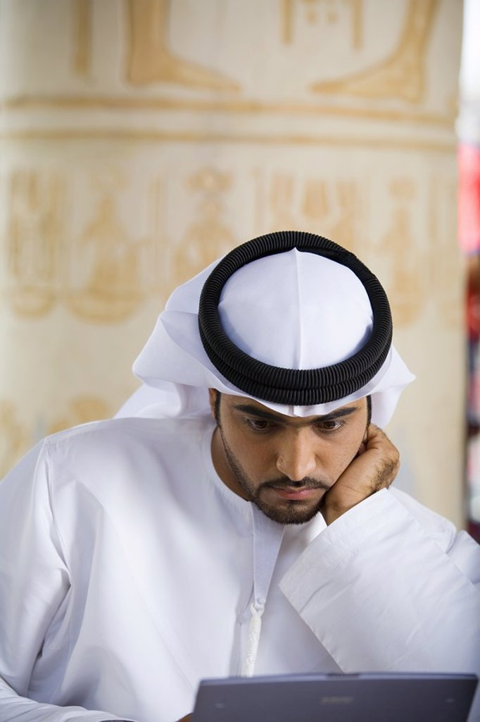 Arab Business Man Focusing on Work in Front of Laptop Computer  Dubai, United Arab Emirates : Stock Photo