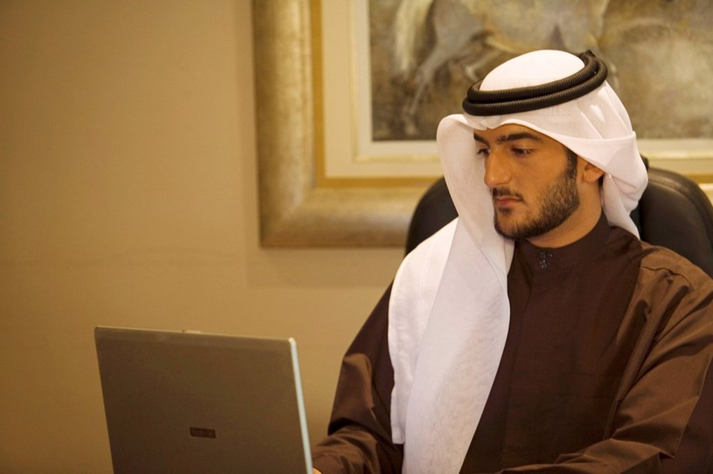 Arab Business Man Working on Computer in Office  Dubai, United Arab Emirates : Stock Photo