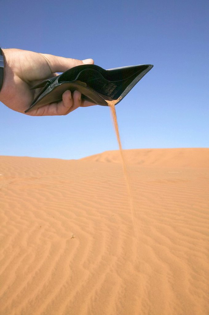 Businessman Emptying Desert Sand from his Wallet  Namibia : Stock Photo