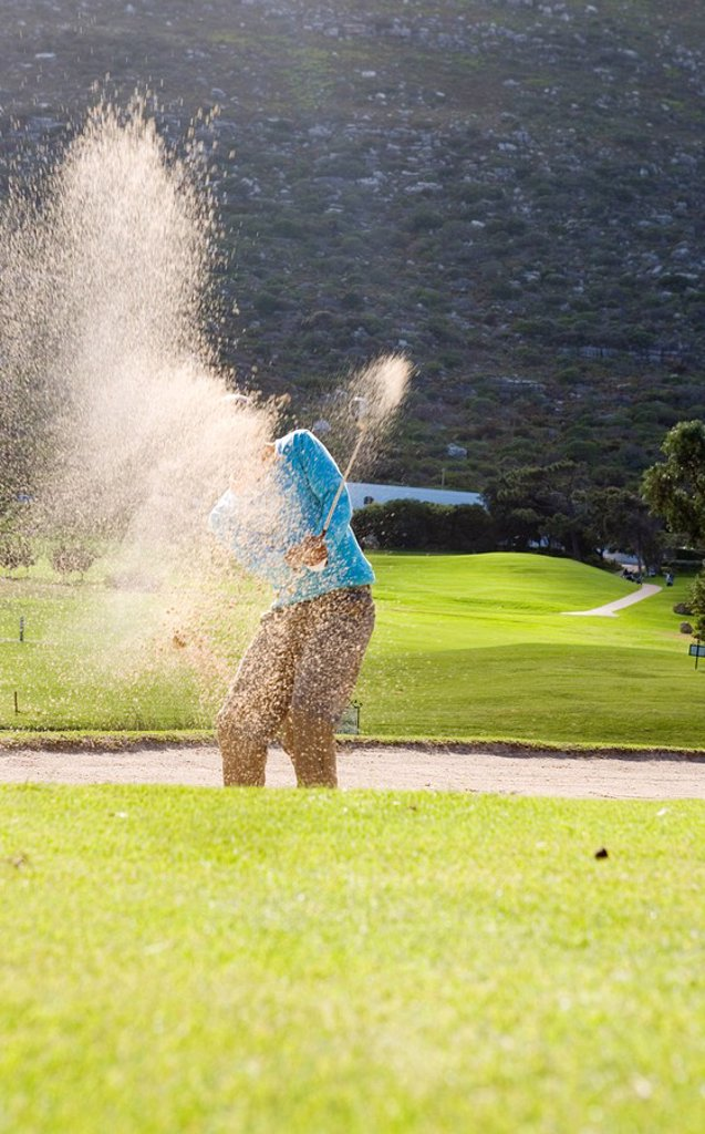 Stock Photo: 1896R-5818 Man Hitting Golf Ball out of Bunker  Clovelly Golf Course, Cape Town, Western Province, South Africa