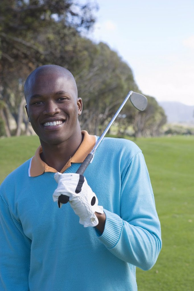 Stock Photo: 1896R-5819 Portrait of Man Holding Golf Club  Clovelly Golf Course, Cape Town, Western Province, South Africa