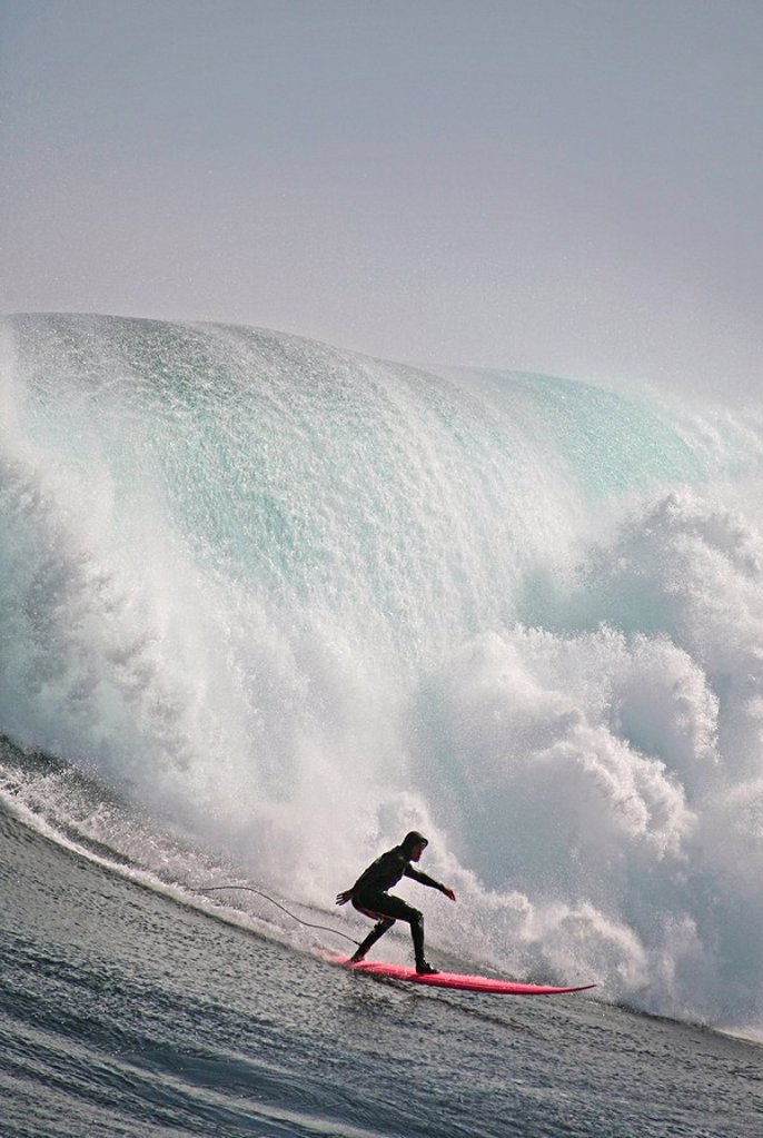 Surfer on a big wave that storms in from the Antarctic each year to hit the infamous offshore reef outside Hout Bay known as Dungeons. Cape Town, Western Cape Province, South Africa : Stock Photo