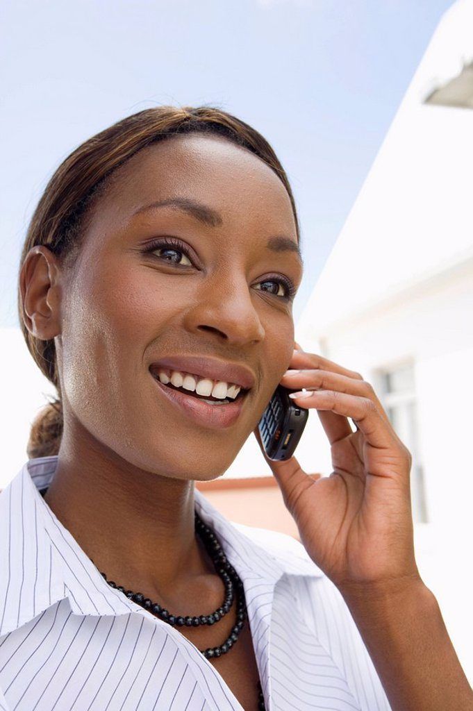 Businesswoman on her mobile phone, Cape Town, Western Cape Province, South Africa : Stock Photo