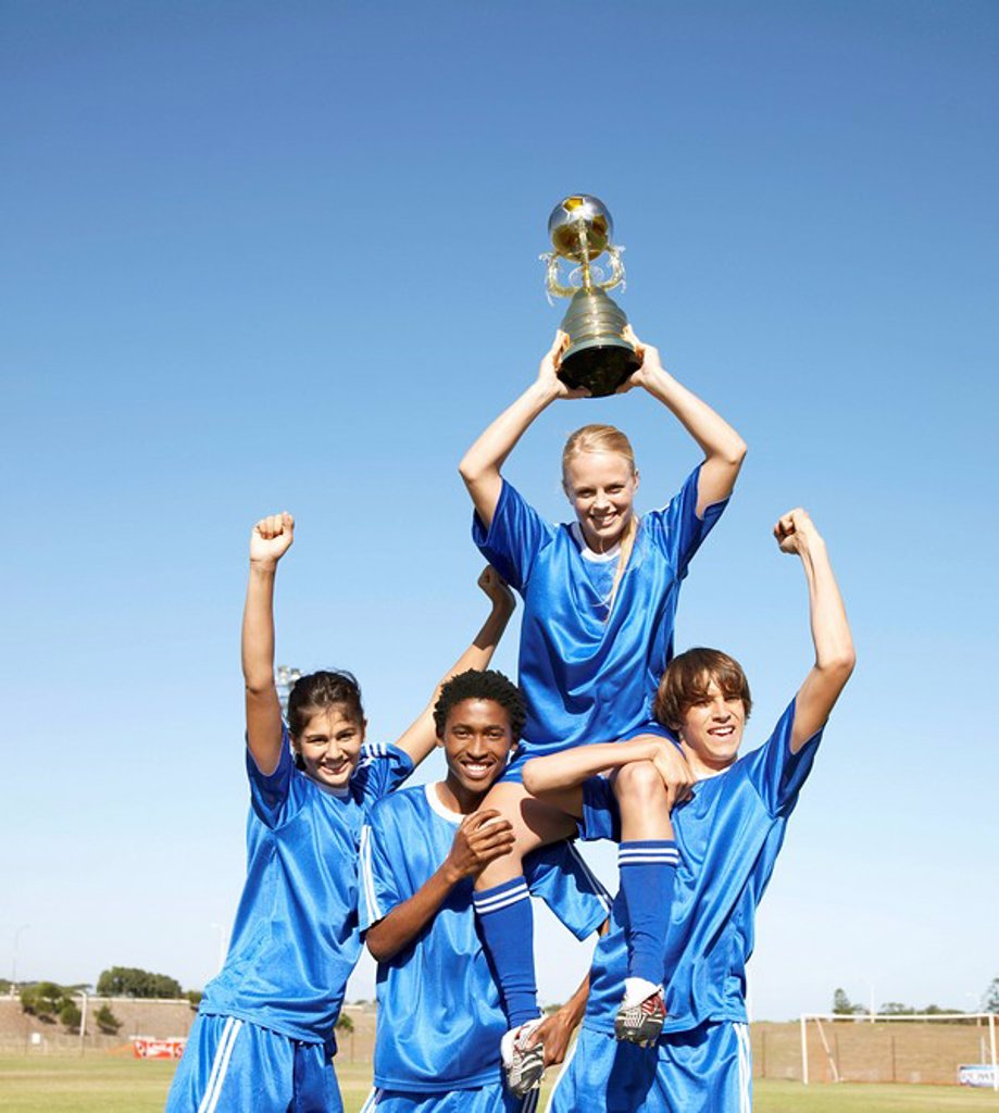 Soccer team holding up winning trophy with pride. Cape Town, Western Cape Province, South Africa : Stock Photo