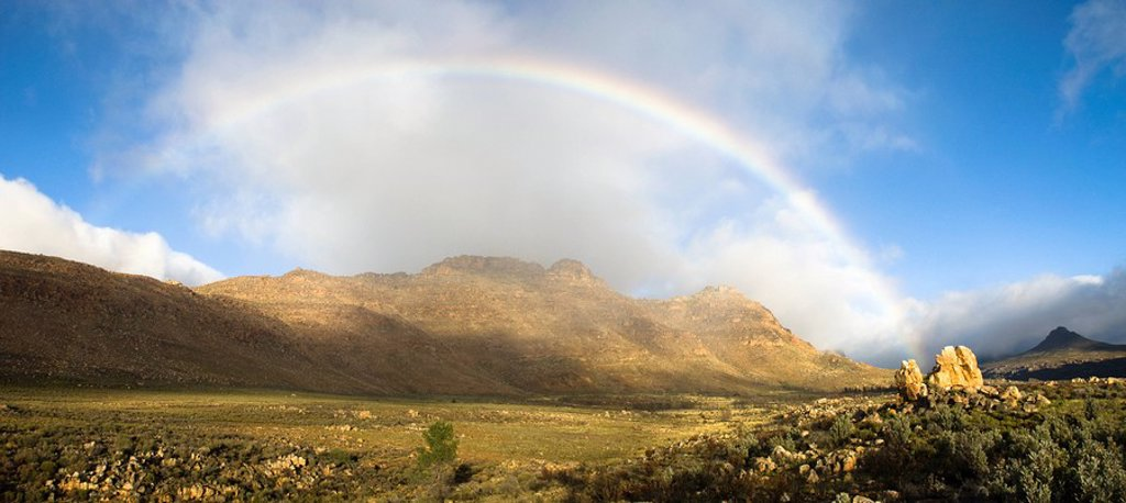 Rainbow over valley and mountains, Krom River, Cederberg Mountains, Western Cape Province, South Africa : Stock Photo