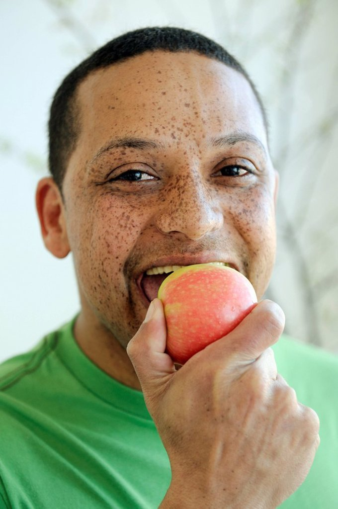 Stock Photo: 1896R-7886 Man with freckles eating apple, Cape Town, Western Cape Province, South Africa
