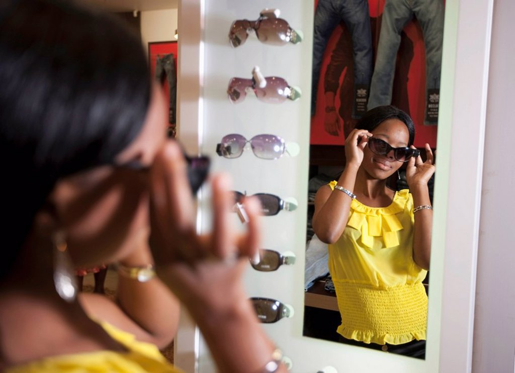 Woman trying on sunglasses, KwaZulu Natal Province, South Africa : Stock Photo