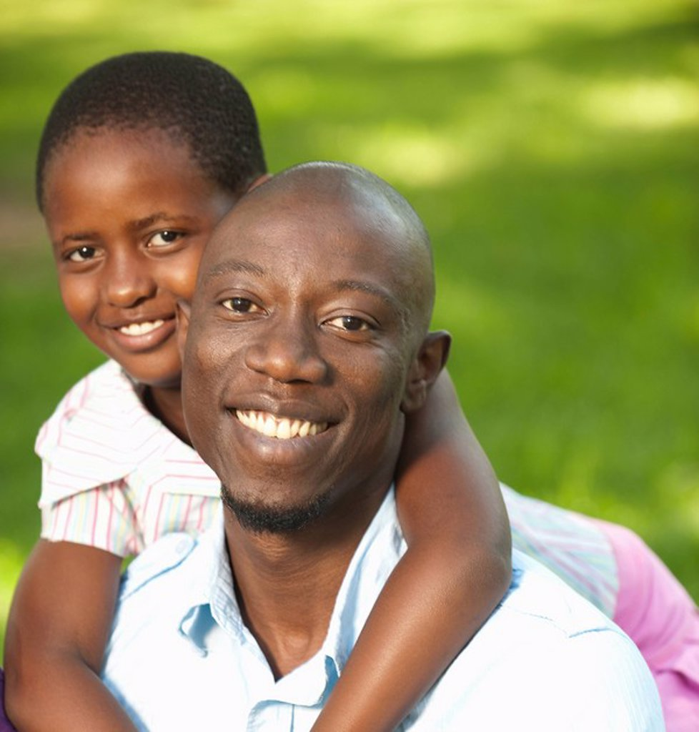 Portrait of girl 8_9 embracing father, outdoors, Johannesburg, Gauteng Province, South Africa : Stock Photo