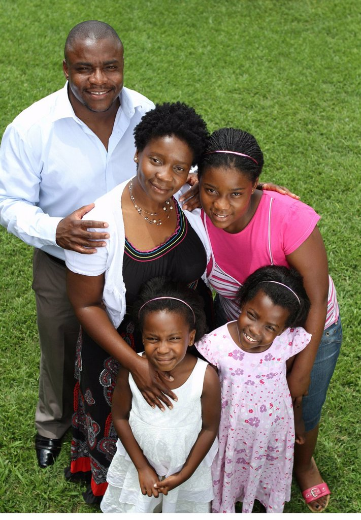 Stock Photo: 1896R-9309 Happy family portrait, Harare, Zimbabwe
