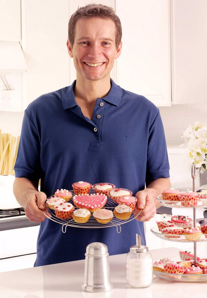 Stock Photo: 1898-13662 Man In Kitchen With Cakes