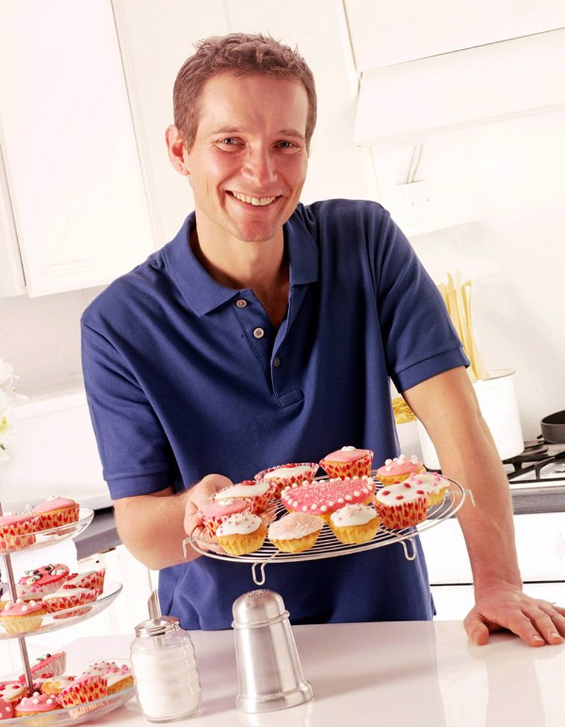 Stock Photo: 1898-13663 Man In Kitchen With Cakes