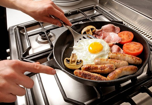 Man Cooking Fried Breakfast : Stock Photo