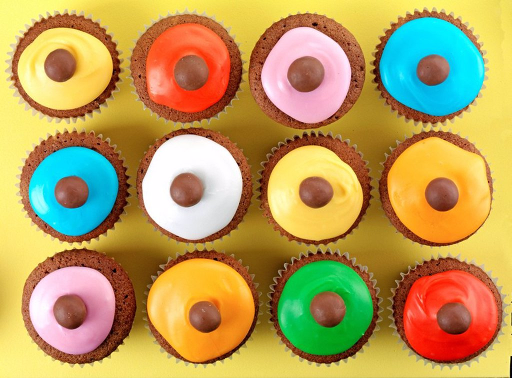 Multi_Coloured Iced Cupcakes Overhead : Stock Photo