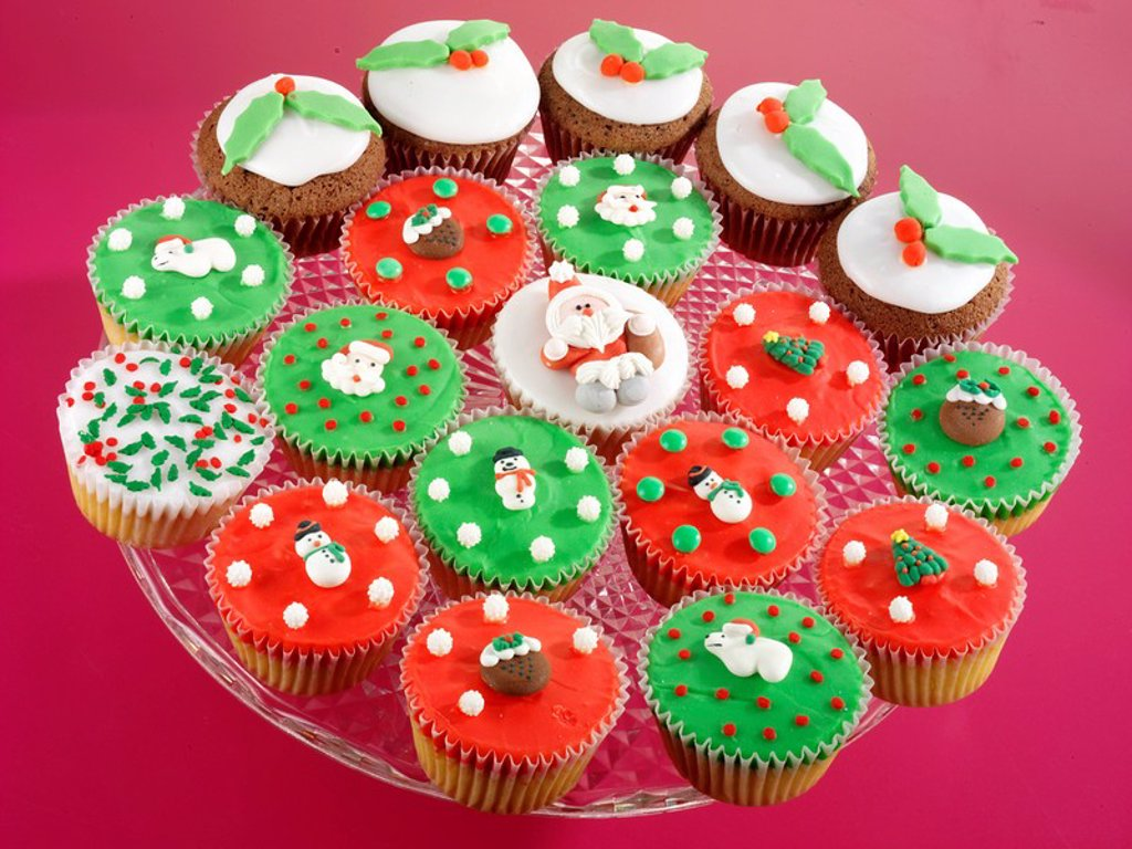 Stock Photo: 1898-14196 Plate Full Of Assorted Christmas Cupcakes