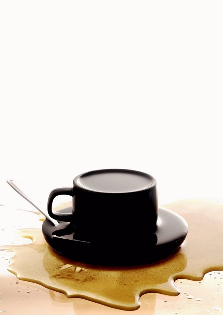 Stock Photo: 1898-17062 An overflowed cup of coffee