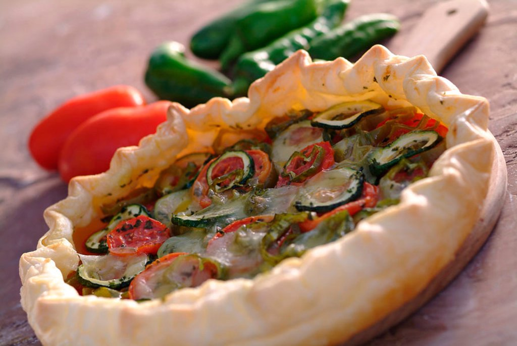 Flaky puff pastry with peppers and tomatoes : Stock Photo