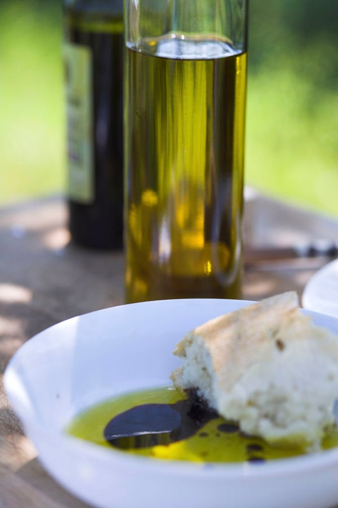 Olive oil and Balsamic vinegar with a crust of bread. : Stock Photo