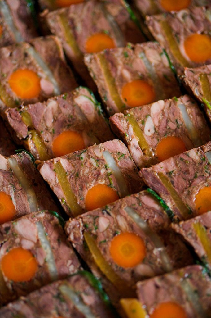 Slices of game and vegetable terrine. : Stock Photo