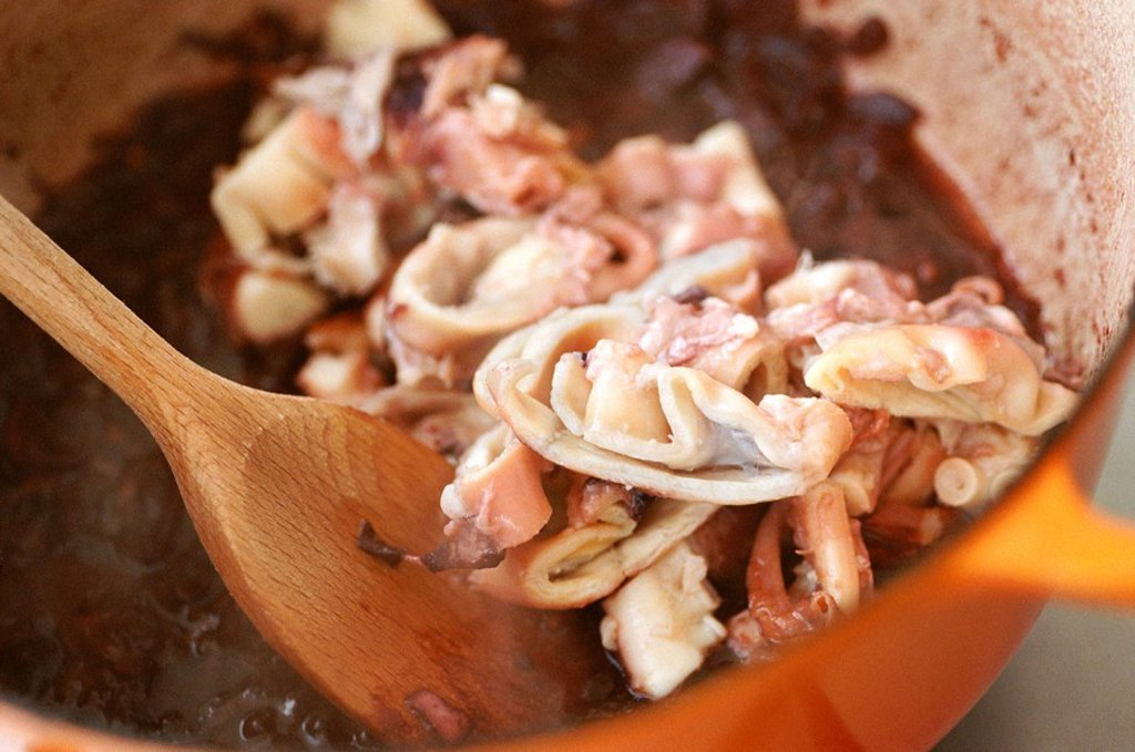 Cooking Octopus and Red Wine Stew : Stock Photo