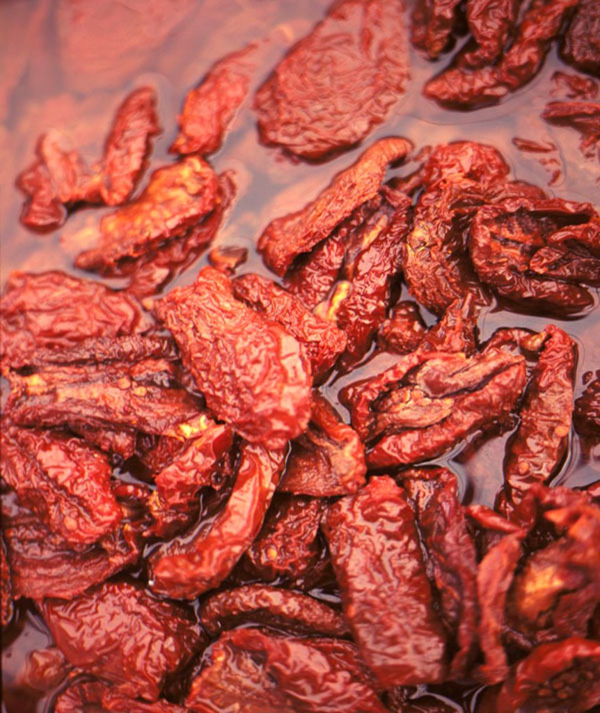 Sun dried tomatoes in oil : Stock Photo