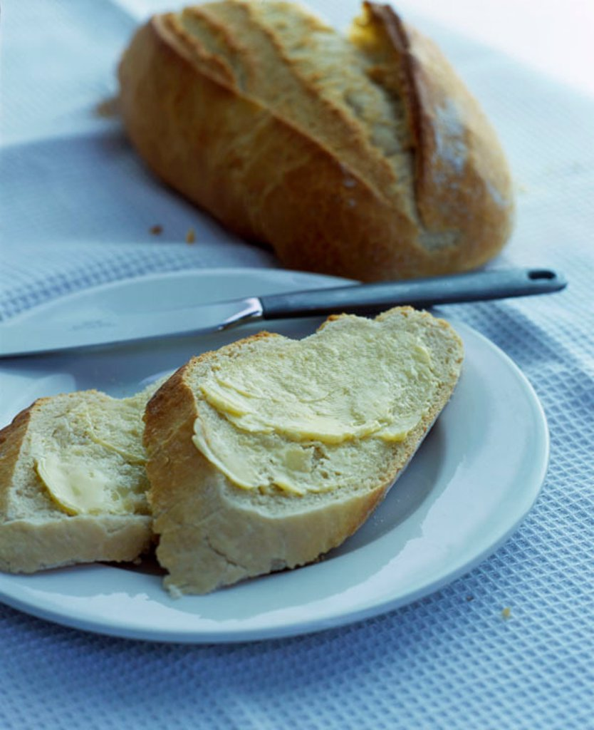 Buttered bread : Stock Photo