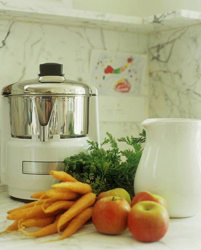 Close up of electric steamer, carrots and apples : Stock Photo