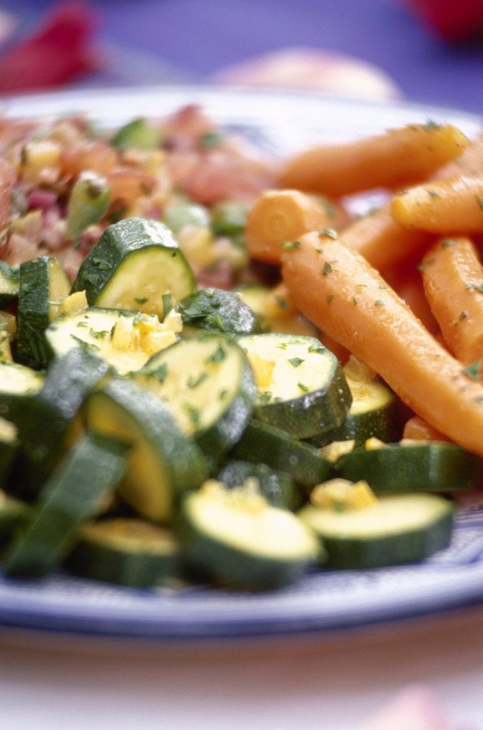 Plate of zucchini and carrot salad garnished with parsley. : Stock Photo