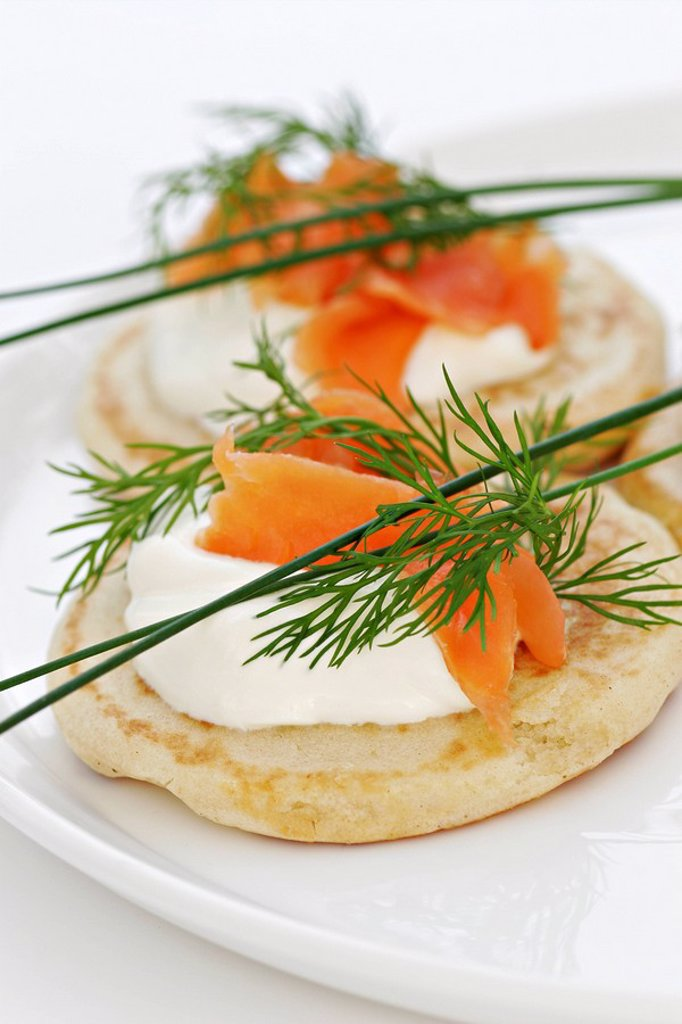 A detail of buttermilk pancakes with salmon and soured cream, garnished with dill : Stock Photo