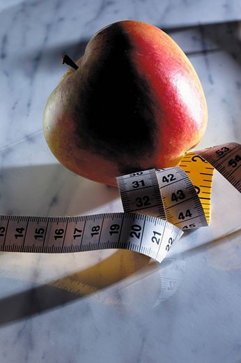 Apple and measuring tape : Stock Photo