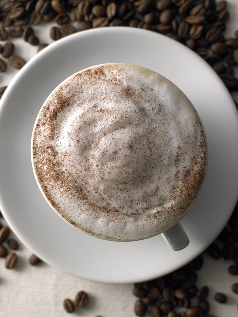 cappuccino with chocolate and coffee beans : Stock Photo