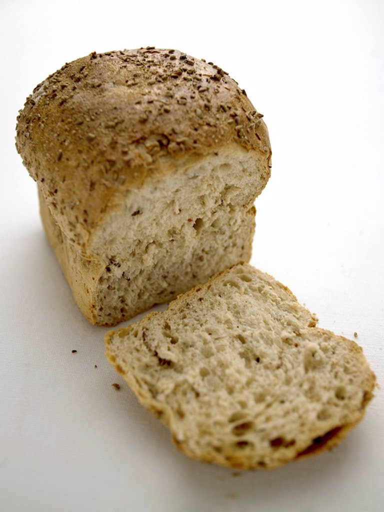 Stock Photo: 1898-3350 Sliced Through Rustic Loaf of Bread
