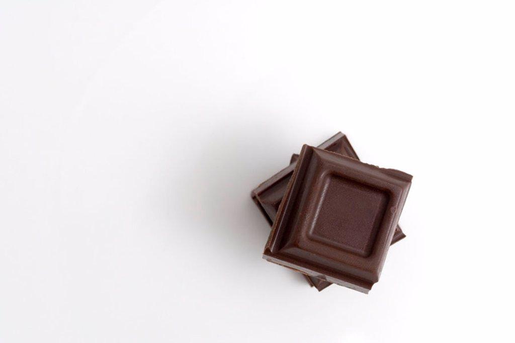 Stock Photo: 1898-3452 Dark Chocolate on a plain white background.