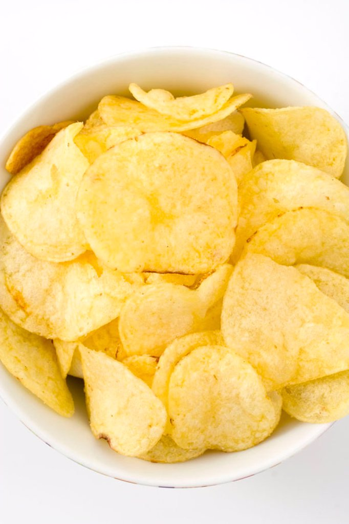Plain Crisps against a white background. : Stock Photo