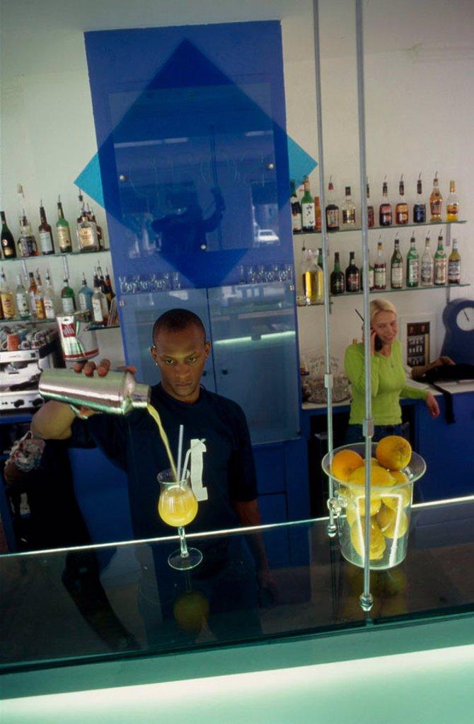 Bartender serving cocktail : Stock Photo