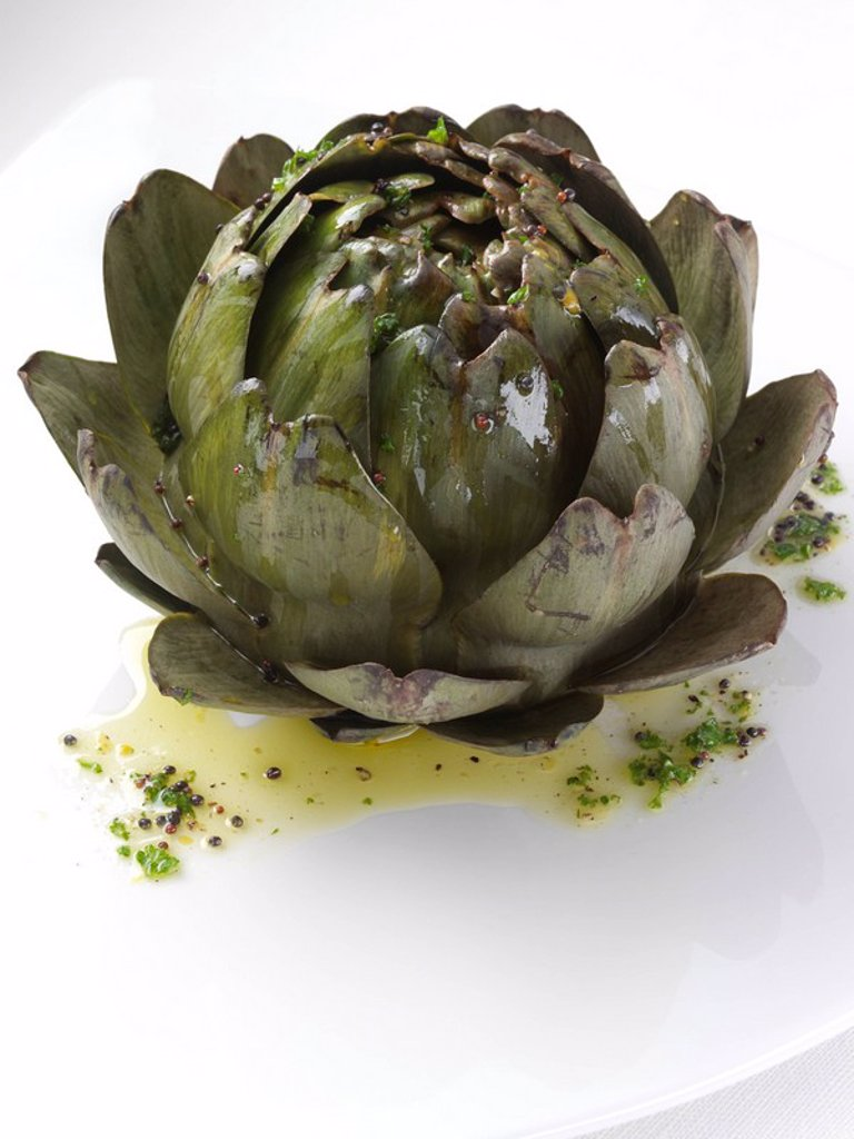 Stock Photo: 1898-37299 Artichoke on a white plate editorial food