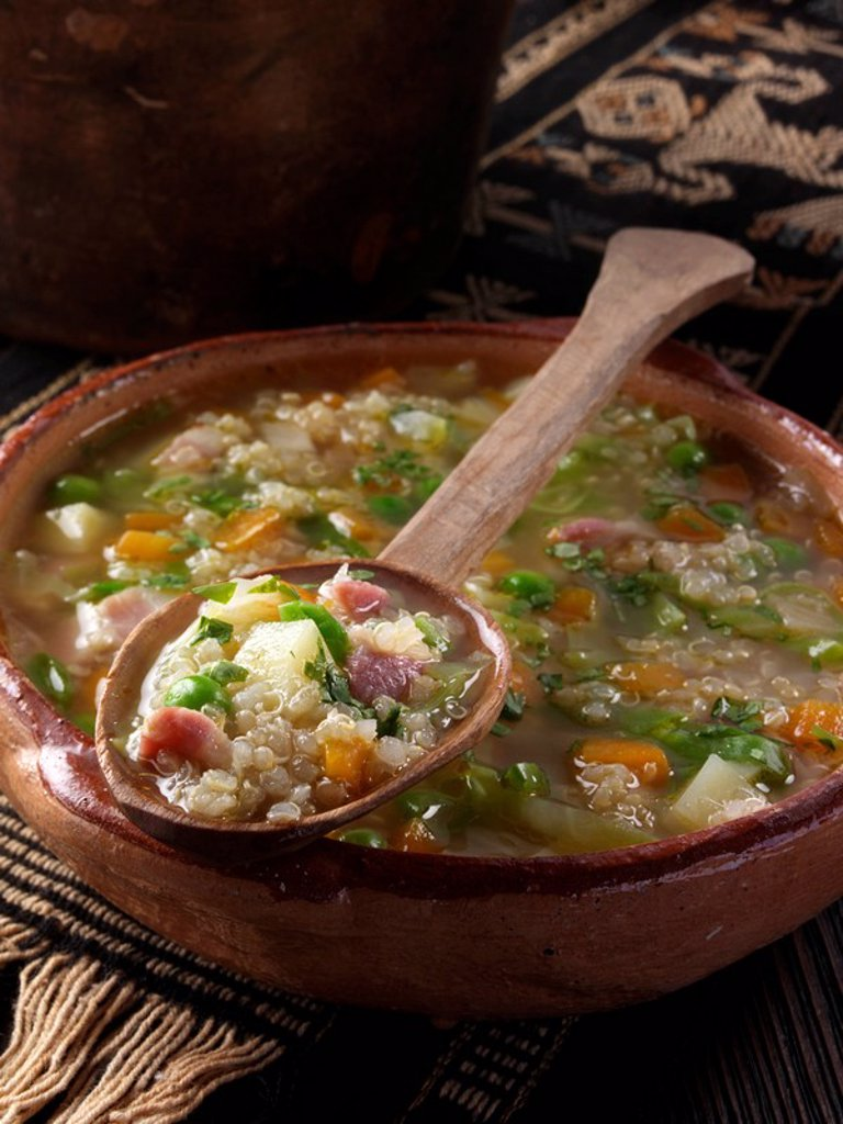 A bowl of quinoa soup with spoon editorial food : Stock Photo