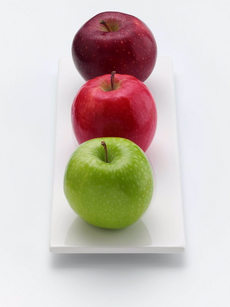 Granny Smith, Pink Lady and a Red Delicious apple on a white background : Stock Photo