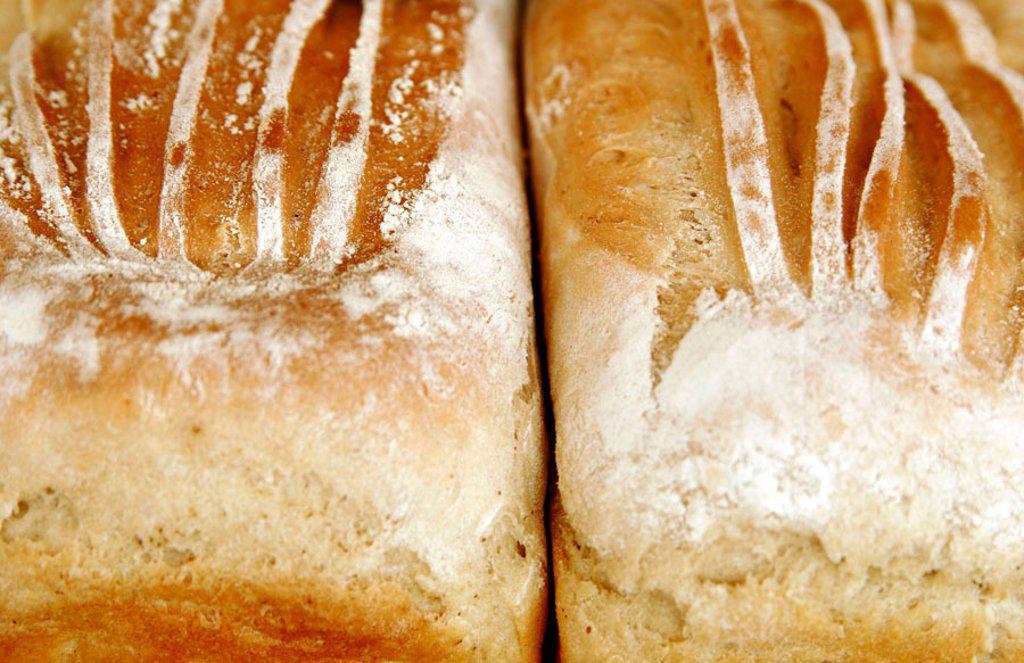 Stock Photo: 1898-4085 Two handmade white tin loaves