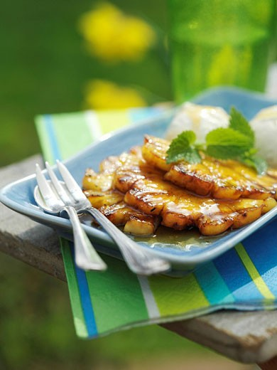 Grilled Pineapple in Caramel Sauce with Ice Cream/ Alfresco : Stock Photo