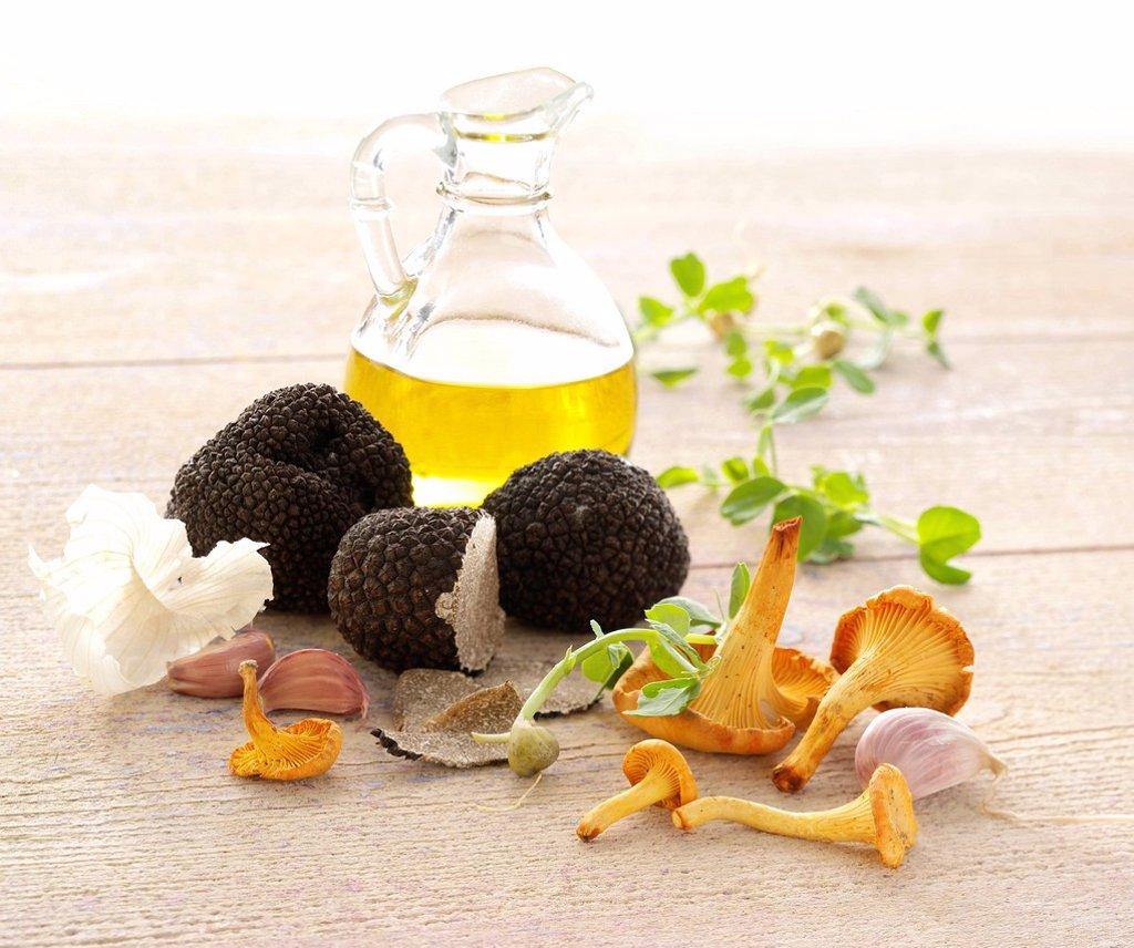 Truffles, olive oil, mushrooms, gralic and pea shoots : Stock Photo