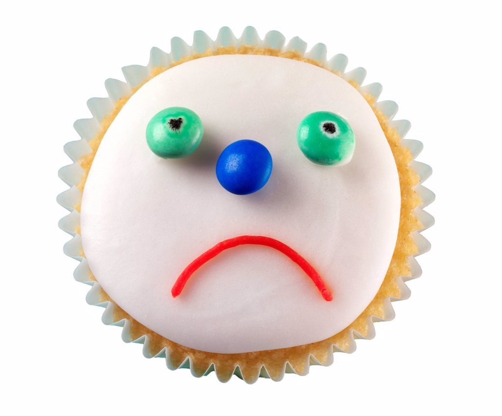 Sad Face Cupcake : Stock Photo