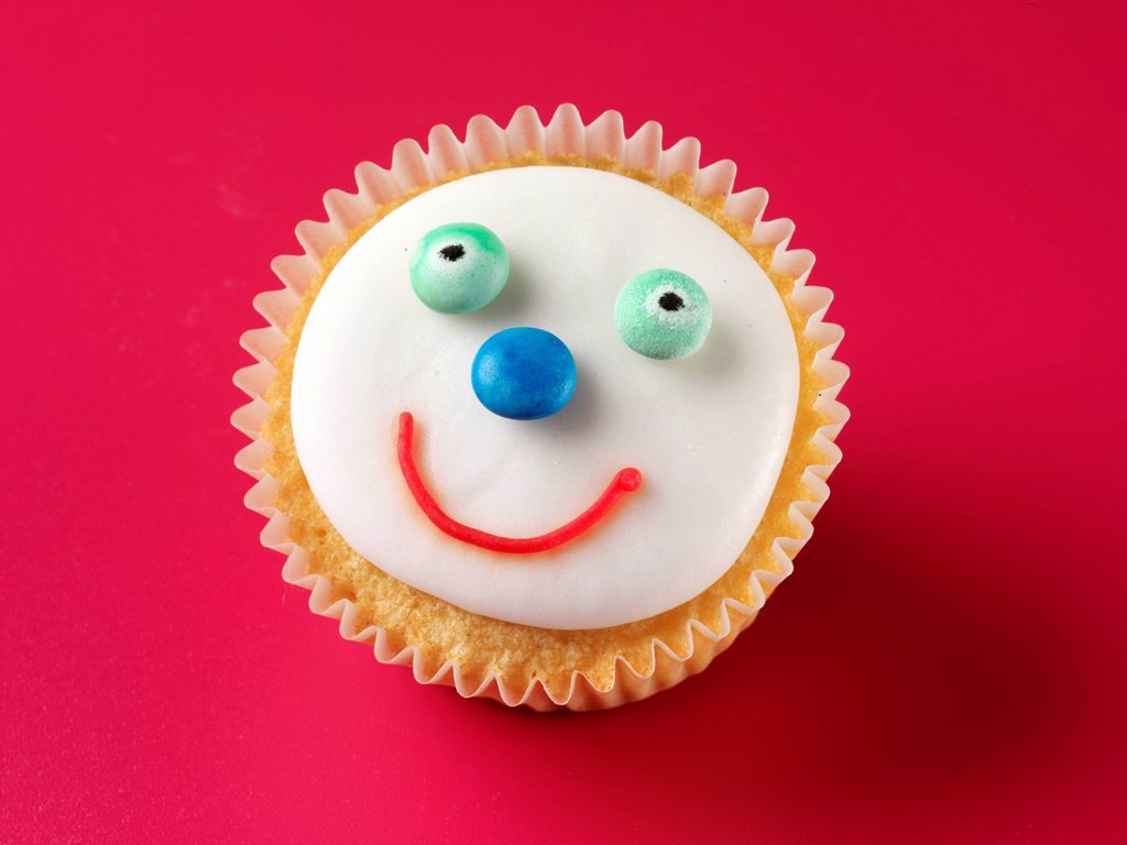Stock Photo: 1898-45611 Happy Face Cupcake