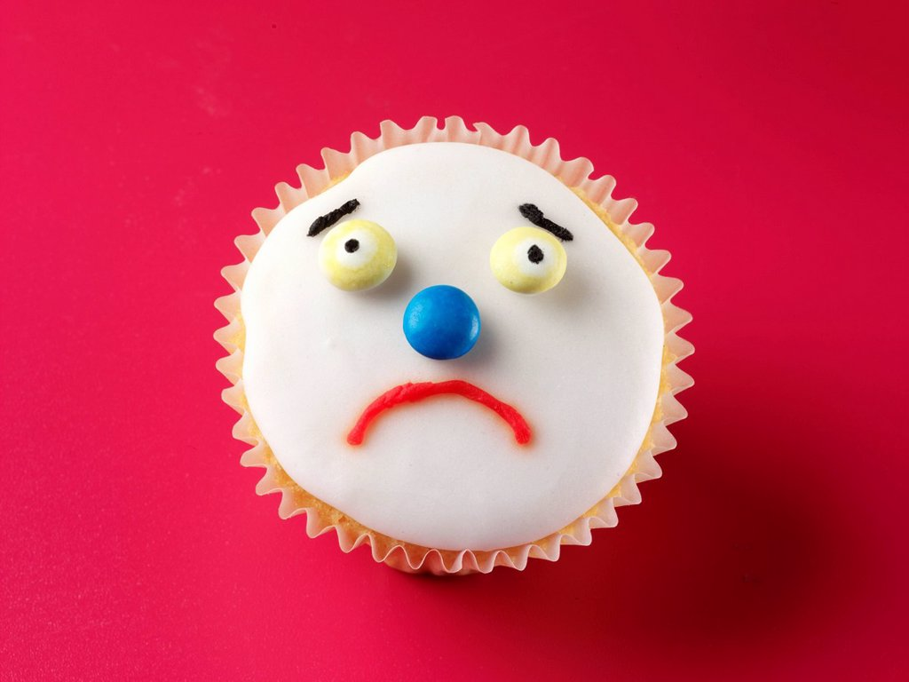 Stock Photo: 1898-45614 Unhappy Face Cupcake