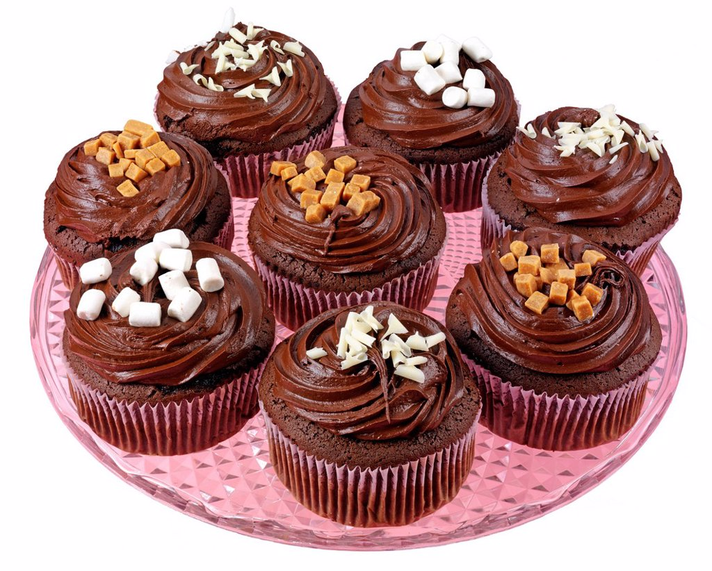 Stock Photo: 1898-45811 Plate Of Chocolate Frosted Cupcakes Or Muffins
