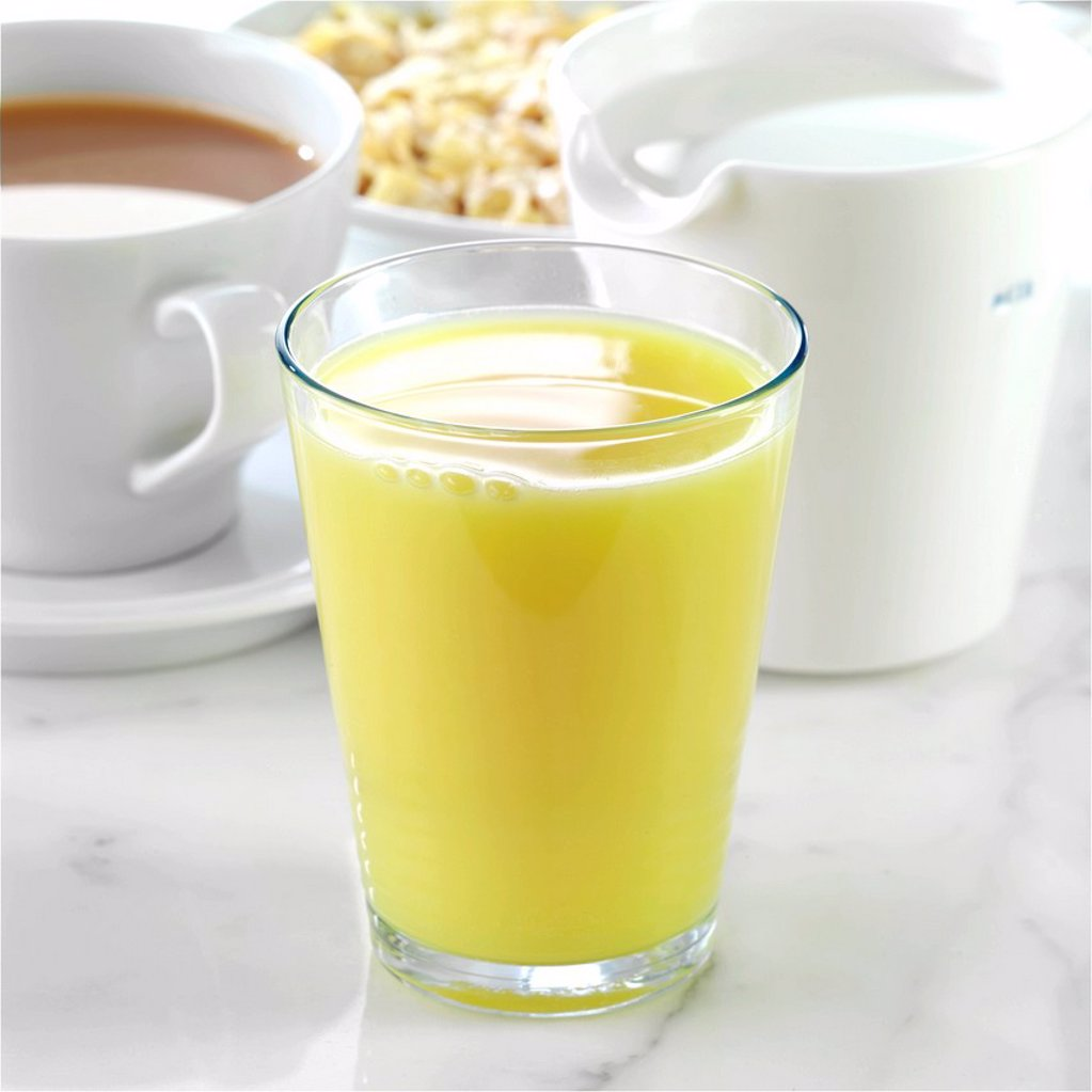 Orange Juice with Tea and a Jug of Milk : Stock Photo