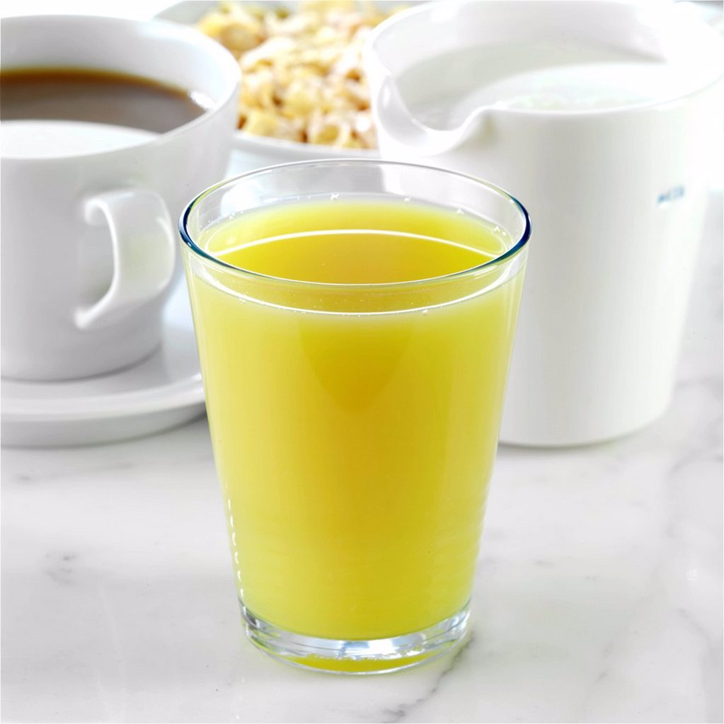 Stock Photo: 1898-46443 Glass of Orange and Pineapple juice at breakfast table