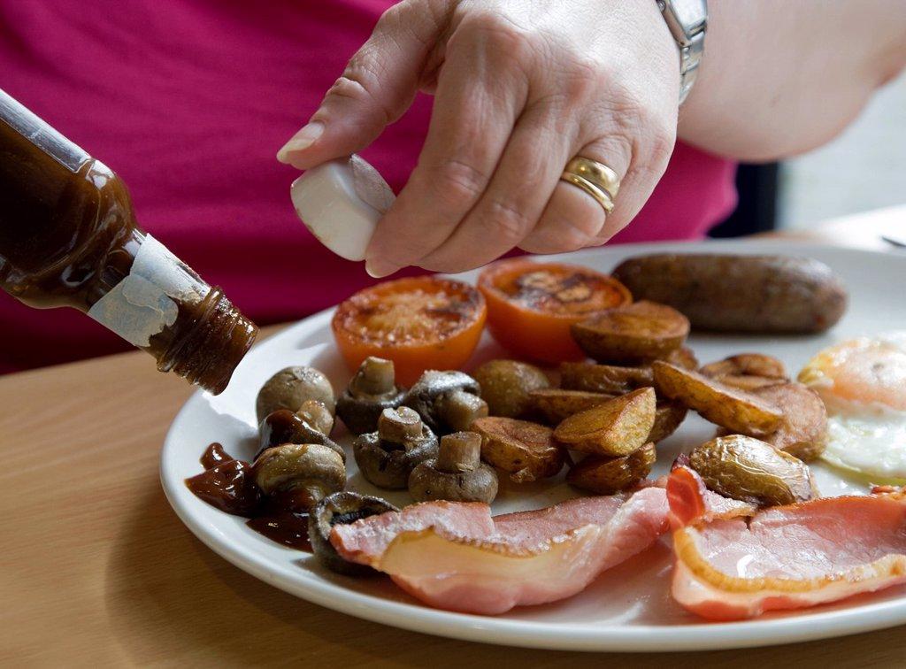 Brown Sauce on a Full English Breakfast : Stock Photo