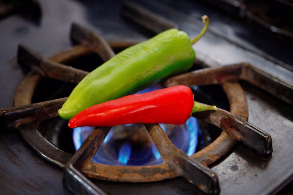 Stock Photo: 1898-47222 Green and Red Chili Peppers over Flame