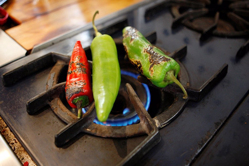 Green and Red Chili Peppers over Flame / Step shot : Stock Photo